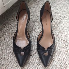 Ann Taylor black d'orsay heels {•} Beautiful black pointed heels with bows. Wear on the soles, but they look great otherwise! Lots and lots of life left. Gorgeous, elegant heels are so versatile! Ann Taylor Shoes Heels