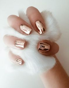 I am in love with this metallic rose gold manicure. I need to get one done
