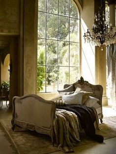 bed in the center of your room, chandelier, huge windows...i love everything about this.
