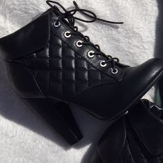 Super cute heel booties. Size 9. Make an offer Brand new retail. Black heels with Light faux fur on the inside. Tie-able laces. 4 inch heels Bamboo Shoes Ankle Boots & Booties
