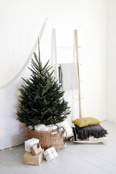 15 Nordic Christmas tree decor ideas The Scandinavian and Nordic decor is becoming more and more popular and if you like this style why not decorate your Christmas … Mini Christmas Tree Decorations, Small Christmas Trees, Noel Christmas, Christmas Tree In Basket, Scandinavian Christmas Decorations, Christmas Christmas, Christmas Plants, Christmas Displays, Xmas Trees