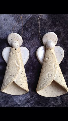 Hand Built Pottery Angel Ornaments by Karen Lucid. I wonder if I could make them out of felt?