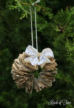 Make a set of Book Page Wreath DIY Handmade Christmas Ornaments with supplies from the Dollar Store ! Beautiful.