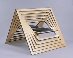 Laser cut chair - Twofold | Matthew Harding. It could be turned on one end to be a card or paper sculpture.