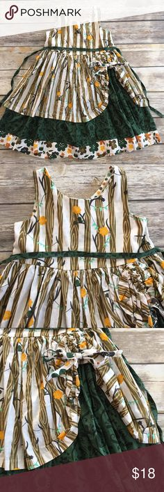 Jelly the Pug Monaco Tenley Dress Green and tan Monaco Tenley dress by Jelly The Pug. Mixed print dress features Woodland scene with pick up skirt showing green detailed skirt. Affixed belt ties in back and buttons at the back assist with changes. EUC. Jelly the Pug Dresses