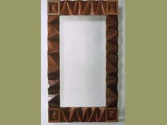 deeply carved wooden mirror frame