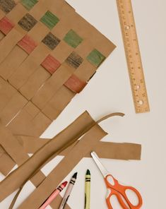 Celebrate Kwanzaa with your fourth grader, or introduce him to a new cultural practice, by showing him how to weave a Kwanzaa mat out of an ordinary paper bag!