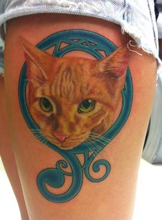 via fyeahtattoos.com. chick paid 250 for this, which seems like a pretty great price b/c though i dislike the blue part, that is a very realistic, well done cat!