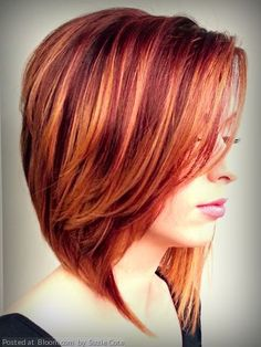 Stunning red fall hair color with diffused highlights
