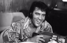 """TTWII - Elvis backstage, reading telegrams:   """"Here's hoping that you have a very successful opening and that you break both legs."""" [Signed.] Tom Jones."""