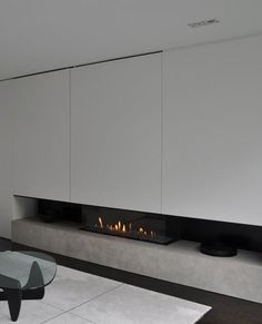 Fireplace in natural stone by vlj-architecten - Noguchi table and wooden tray by Michael Verheyden