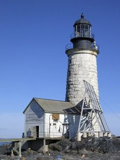 "Portland, Maine-""The battered lighthouse stood proudly on the rocky shore warning the sailors of the dangers there."""