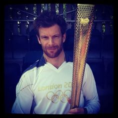 Tom Aikens carries The Olympic Torch from Chelsea Bridge