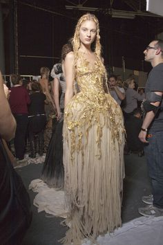 30 backstage photos of Alexander McQueen at Paris Fashion Week Spring 2011.