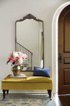 velvet bench in entryway with roses — via @TheFoxandShe