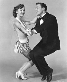 Full publicity shot of Gene Kelly as Don Lockwood dancing with Debbie Reynolds as Kathy Selden.