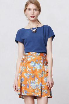 Not a huge fan of the skirt's style but the pattern paired with the color of the top is lovely.