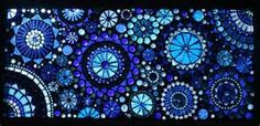 ... glass gems circle around to form a beautiful glass mosaic window pane