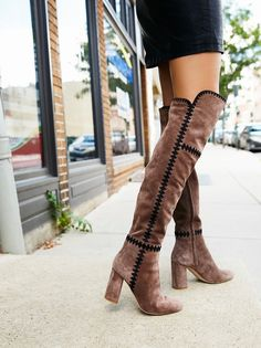 Tall over-the-knee suede boots featuring geometric embroidered designs and a wide opening with elastic for an effortless fit. Chunky block heel for a comfortable step. Side zipper closure for an easy on-off.