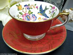 Aynsley tea cup with bird and floral pattern inside