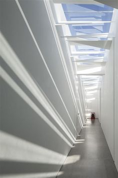 Minimalist House  // modern hallway and skylight element that creates sculptural shadows at the White Gallery House // Pitsou Kedem Architect