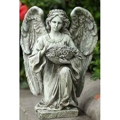 """15"""" Serene Kneeling Angel Holding Flowers Outdoor Patio Garden Statue Figure by Roman. $59.99. Kneeling Angel Garden StatuePosed kneeling Angel with a basket full of flowersFeatures a realistic gray concrete style finishFor indoor/outdoor useDimensions: 15""""H x 11""""W x 8.5""""DMaterial(s): resin/stone mix"""