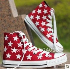 red Converse shoes with white stars on them