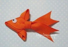 FISH DIY: Ribbon Goldfish by Vera Yates Ling for LoveMyTapes. Originally created as a greeting card emellishment, but would be so cute as a barrette for a fish-themed birthday party. DIY - includes full instructions and pictures. Ribbon Crafts, Ribbon Bows, Fabric Crafts, Paper Crafts, Diy Ribbon, Ribbons, Ribbon Hair, Grosgrain Ribbon, Fun Crafts