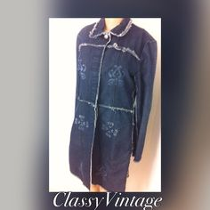 Fun knee length denim jacket. Fun jacket with a retro look. Fabric panels on sides with a used And frayed look. Stenciled design on front and back. with hidden buttons. Big side pockets. No flaws. Tag size medium. 60 % cotton, 36% polyester and 4 % spandex. Rave 4 Real Jackets & Coats Jean Jackets