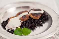 Pork tenderloin marinated in sherry served over black rice with gorgonzola sauce