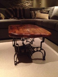 """Cutest little coffee table. Antique cast iron base recycled from an old """"White"""" sewing machine topped with a chunky solid piece if barn board smoothed down to a soft satin finish."""