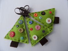 Felt Christmas Tree Decorations from MissyMaddoxDesigns @Etsy for  £5.99: 3x Felt Christmas Tree Decorations. These 3 beautiful handmade trees will be a wonderful addition to your Christmas tree this year. Each made with quality felt, contrasting thread and button detailing. Lightly padded with a ribbon loop. Each measures approx 10cm x 8cm