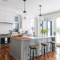 Marble Top Island with Built In Wood Cutting Board. Regina Andrews light fixtures.
