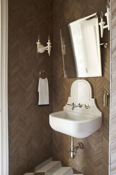 Powder Room with Brown Herringbone Wall Tiles and Marble Wall Mount Sink