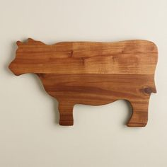 Crafted of acacia wood, our adorable Cow Cutting Board provides a durable cutting surface with the rustic appeal of natural wood grain.