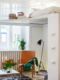 love this loft look with a spiraling out rail, doesn't kill the light