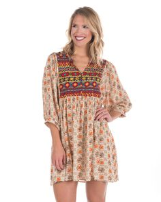 Umgee USA | Women's Printed Baby Doll Tunic Dress Have an eye-catching outfit when wearing this mid-thigh length women's Baby Doll tunic. Made from cotton/poly blend, this dress stands out with a floral printed body and Aztec printed bib designs.| Country Outfitter