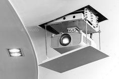 Projector hang on ceiling in meeting room. http://photodune.net/item/projector/10303068