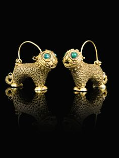Persia | Pair of gold earrings; lion form, decorated with twisted wire and inset green and turquoise stone eyes | ca. 12th century | 9'375£ ~ sold (Apr '14)