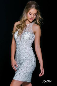 Summer whites are in with this illusion back #jovani 37946 beaded dress.