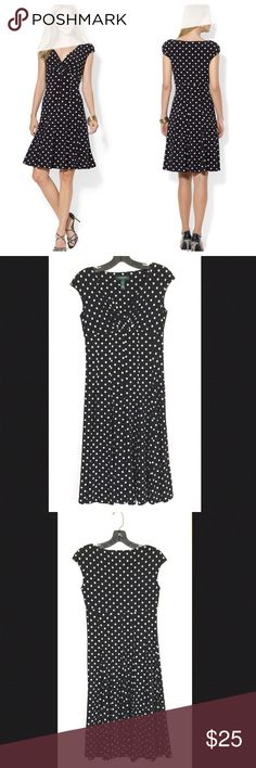 "Ralph Lauren Polka Dot Dress Lauren Ralph Lauren Polka Dot A-Line Dress.  Pull over, cross over V-neck, slightly padded shoulders, cap sleeves, flouncy panel skirt extends from the empire waist.  Falls about 25"" from the natural waist and 16"" across the armpits.  Polyester/elastane.  Machine wash.  In great pre-owned condition.  No tradesy Lauren Ralph Lauren Dresses Midi"