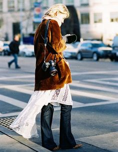 A velvet jacket is paired with a lace dress, jeans, and printed heels. #fleastyle