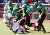 Drake 38, San Rafael 16. Alan Garcia of San Rafael is chased down by half the Drake defense.