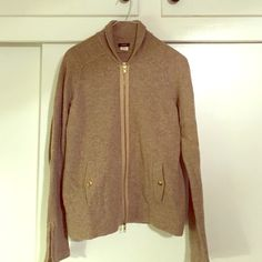 J.Crew gold merino wool sweater Very cute tan with gold zip up sweater. Gold hardware and detail on pockets. It has a gold glimmer sewn into it which is very cute for the holidays. Size medium worn once in non smoking home. J. Crew Sweaters Cardigans