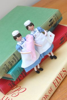 1940's style Nurse and Midwife Art Dolls with wooden heads and poseable bodies. Available to purchase from my Etsy shop. Designed and made by Helen from Isabella's Secret Attic.