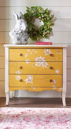 Our romantic, handpainted Millie Chest looks like it came from a fairy tale. And like a fairy tale, it has a sweet surprise: the three drawers are painted a different, solid color than the rest of the chest, for a touch of cheerful fun whenever you pull them open.
