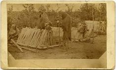 """Louis Riel Photos Show Up At Australian Auction: Three First Nations people at the site of several graves somewhere between 1873 and 1875. This photo has shown up multiple times throughout Canadian history. The University of Manitoba writes that according to Dr. Katherine Pettipas """"The grave types are definitely Ojibwe (Anishinaanbe) style."""""""