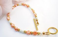 Peach and White Pearl Bracelet by CraftingMemories1 on Etsy