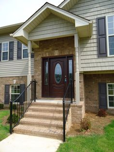 Front Entry: portico on raised ranch.  not this style, but this is an example of how one would fit it into the eaves.