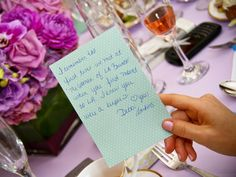 At this shower, guests were asked to jot down their favorite memory with the bride — how sweet is that?See more photos from this purple-themed bridal shower ►Photo Credit: Laura Laing